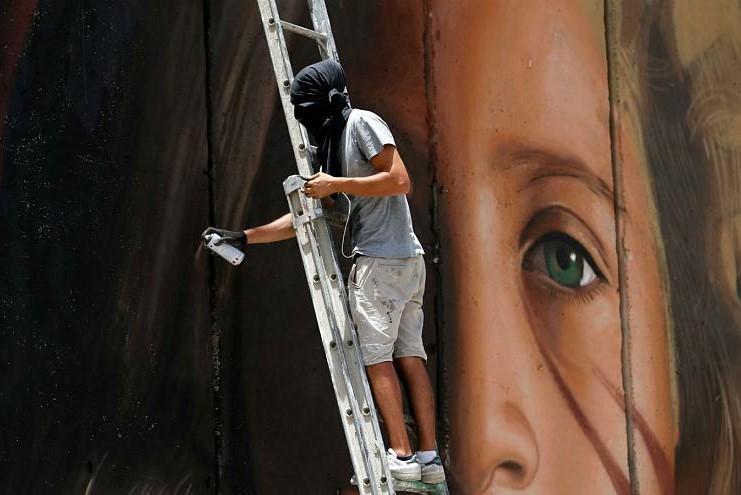 Will Itallian street artist arrested in Israel be released?