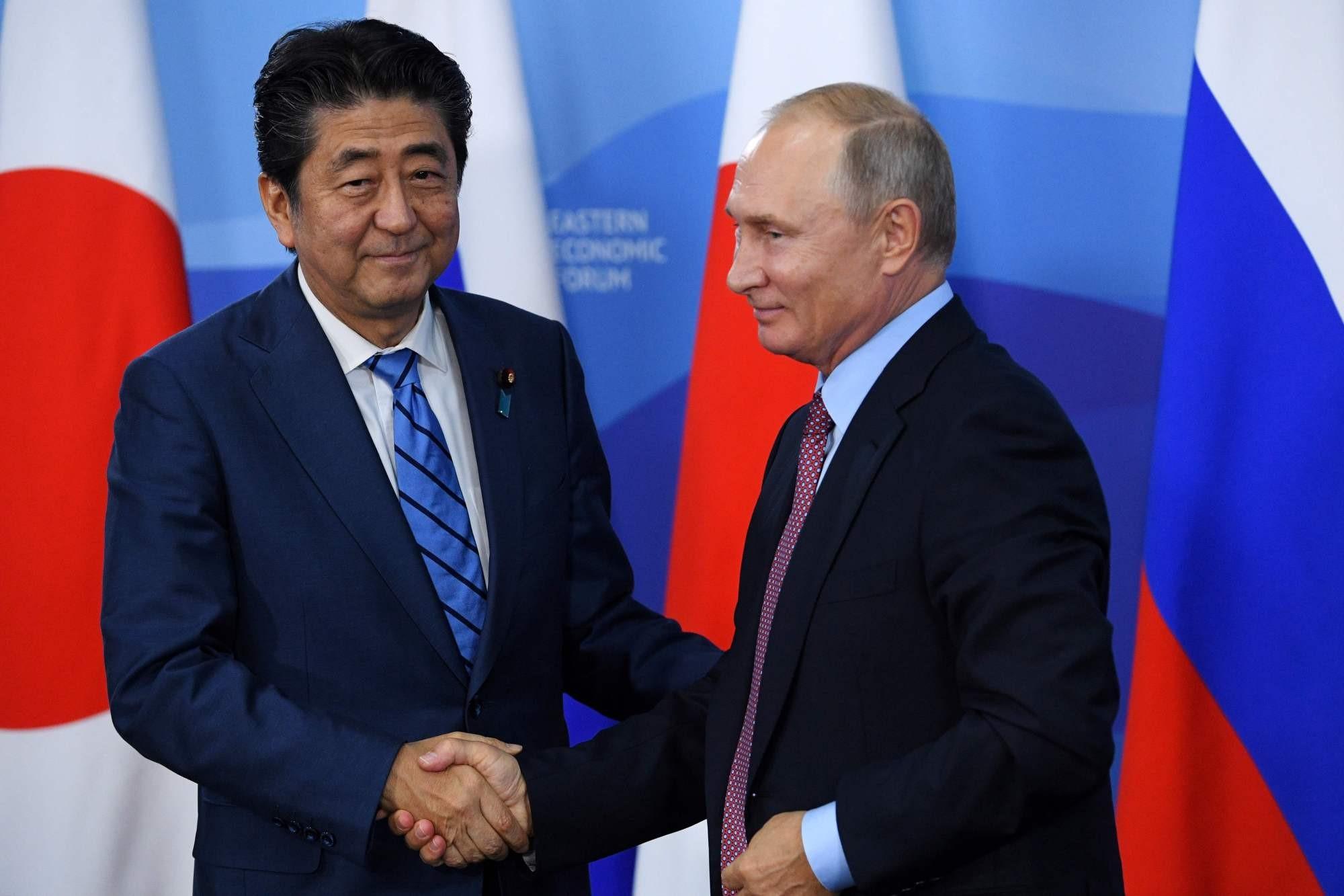 Abe, Putin